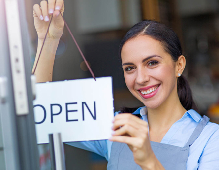 Business owner opening her store