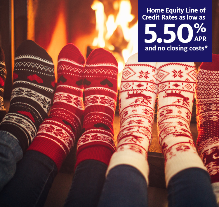 Socks warming feet by the fire with APR for home equity banner