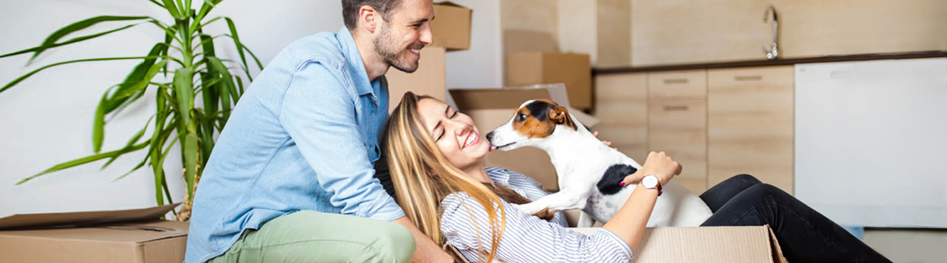 couple and dog moving in home.