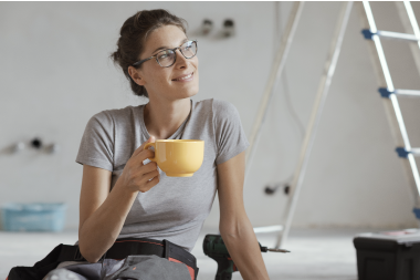 woman drinking coffee working on home improvement